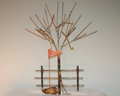 Golf clubs in tree: Copper, brass, bronze and steel metal art  wall sculpture.