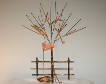 Golf clubs in tree: Copper, brass, bronze and steel metal art  wall sculpture.