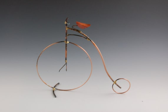 PENNY FARTHING, old fashion giant bicycle,high wheel,copper,bicycle ,sculpture,