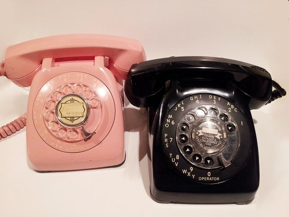 Pink and Black His-and-Hers Rotary Phones