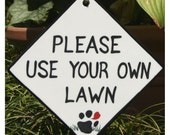 Dog Yard Sign Asks Politely For A Dog Walker To Clean Up After Their Dog's Mess, a change of pace from the no poop signs