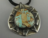 Sterling Silver necklace, with Turquoise, and Brown stone from the Royston mine in Navada.