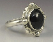 Sterling Silver Ring, Black Onyx round stone, and embellished.
