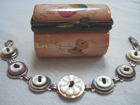 Vintage Mother of Pearl button stacked bracelet with deep purple bead accents.