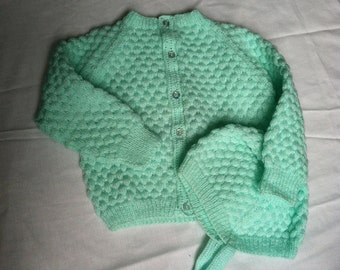 Hand knit baby sweater and cap