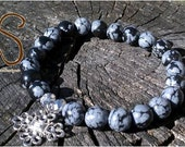 Snowflake Obsidian round beads with silver accent charm.