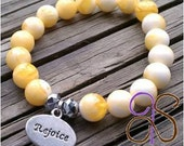Yellow marble beaded bracelet with silver REJOICE charm