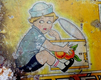 Old marmalade tin box made in Spain. Vintage cute baby boy eating sweet fruit