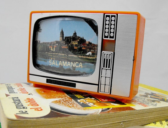 Retro plastic TV with slides of Spain. Vintage televisor from 70s 80s. Salamanca city