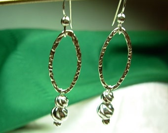 Sterling silver (.925)  dangling earrings.