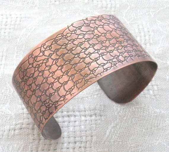 Copper cuff with knitted pattern