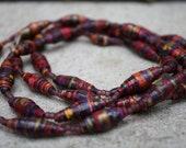 Extra long purple, maroon and burnt orange paper bead necklace
