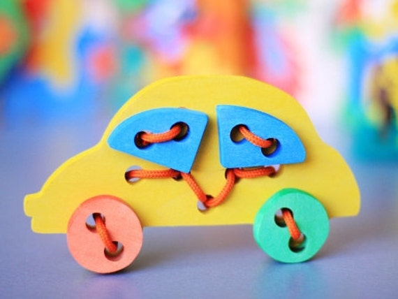 Colorful Wooden Puzzle with laces CAR. Handmade puzzle game that develops motor skills. Kids toy. Wooden ecofriendly toys for children