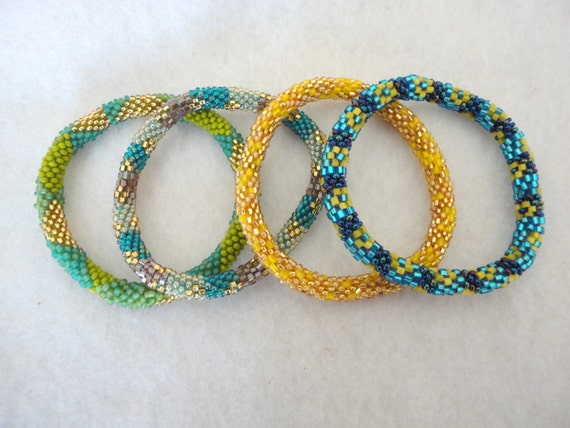 Set of 4 gorgeous beaded bracelets - green, yellow, blue, golden and rainbow black beaded bracelets
