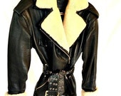 Vintage leather jacket with shearling lapel and cuffs