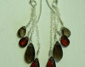 Faceted garnet and smoky quartz dangle earrings in sterling silver