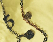 steampunk necklace with three charms and copper and brass chain