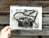 "Camera lino print on Vintage French art magazine ""Opera"""