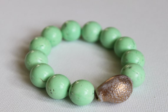 Spring bracelet - Classic, modern & preppy. Spring green howlite stone beads anchored with vintage resin shell bead