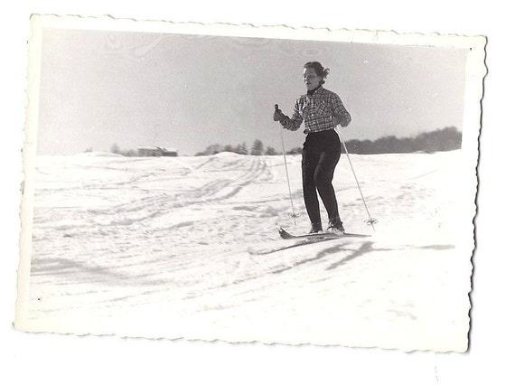 Vintage photo, retro 1957 jumping skier