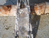 Ti and fine silver striped heady crystal wire wrapped pendant fluorite oct. glows purple under backlight psytrance