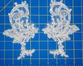 2 white paisley shaped lace appliques