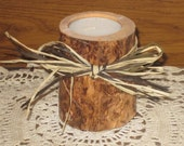 Pine tealight candle holder decorated with black and tan raffia.