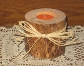 Pine tealight candle holder decorated with tan raffia.