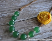 Ellie. Green beaded adjustable necklace with yellow rosette