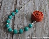 Elisa. Turquoise beaded necklace with orange rosette