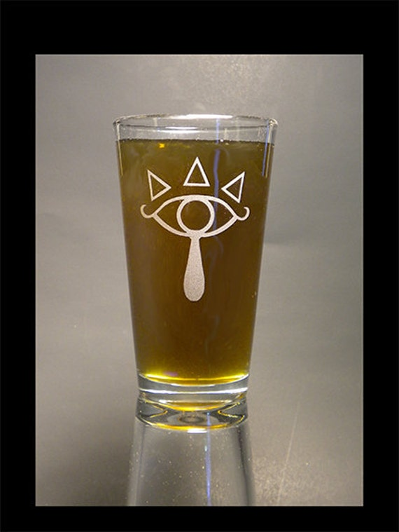 Sheikah emblem on a pint glass
