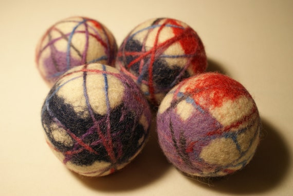 4 handmade wool dryer balls as shown in the 1st pictures. wet felted and needle felted.