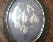 Blue and silver flower brooch