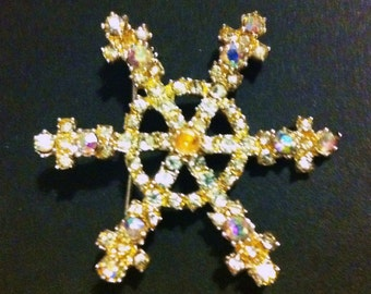Bejeweled snowflake brooch