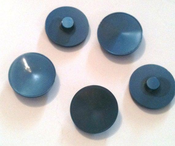 Blue plastic buttons