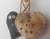 Ivory felt decorated hanging heart