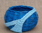 Blue bowl handmade from recycled newspapers (paper wicker)