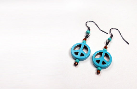 turquoise peace sign earrings with turquoise and orange accent beads