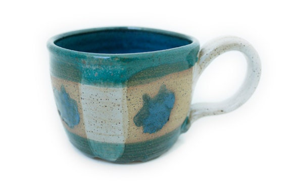 Green, teal blue and white sunburst ceramic stoneware mug