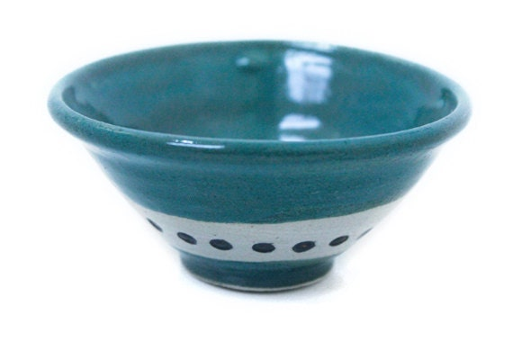 Teal green small stoneware ceramic bowl with dark dots