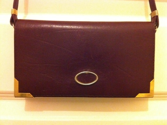 Circa 1970s Vintage Burgundy Mini Leather Handbag with Leather Shoulder Strap