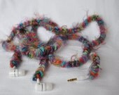 Cute Panasonic earbuds with fluffy, colorful crocheted cord cover