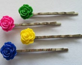 """Set of four, perfect """"pop of color"""" resin flower cabochons on silver heavy duty bobby pins, in pink, blue, yellow and green."""
