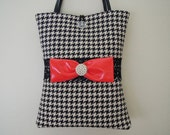 THE TOTE BAG in Black and Off White Houndstooth Pattern with a Red Bow and Pearls.
