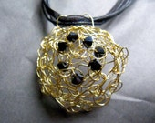 Gold Wire With Black Crystal Pendent On a Navy Ribbon and Cord Necklace