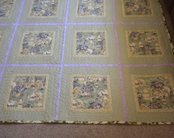 Queen sized/,olive green and lavender quilt