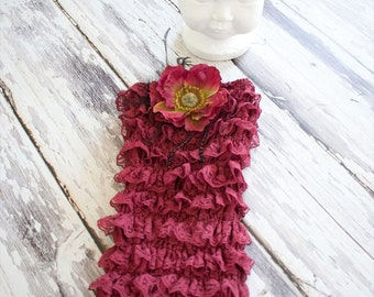 Vintage Burgandy Lace Romper embellished with flowers, bead, and feathers.
