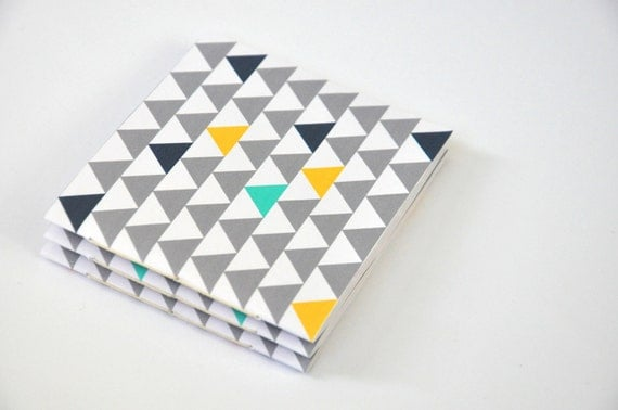 Three little notebooks with triangles
