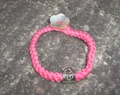 Hot Pink Crochet Cord Bracelet With Handbag Charm and Flower Shell Button