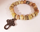 Carved Soapstone 9mm Beads and Metal Celtic Cross Charm Unisex Bracelet